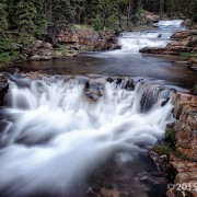 As the Provo River plunges off the south side of the Uinta Mountains along the Mirror Lake Highway, it cascades over innumerable ledges of Precambrian-age Uinta Mountain Group sandstone. Provo Falls, Summit County, Utah Photographer: Gregg Beukelman; © 2015