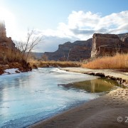 Short days and low winter sun cause ice to form along the San Rafael River where it cuts through the west flank of the San Rafael Swell. The 1,100-foot-deep canyon exposes the Jurassic-Triassic-age Glen Canyon Group along the cliffs and ledges of the canyon walls. Little Grand Canyon of the San Rafael River, Emery County, Utah Photographer: Zach Anderson; © 2016