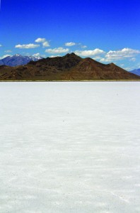 The Bonneville Salt Flats is a dazzling white, salt-covered area in northwestern Utah; Silver Island Mountains with Lake Bonneville shorelines viewed to the north.