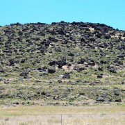 These large, dark basalt boulders are about two million years old (Tertiary Lava Ridge Basalt). View of Lava Ridge.