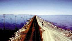 Modern rock-fill causeway located parallel to, and 1,500 feet north of, the old trestle; view is westward across the lake toward Lakeside.