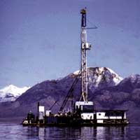 Oil occurs in natural seeps on the north shore of the lake, and drilling in the late 1970s disclosed additional oil beneath the bed of the lake.