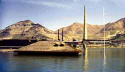 The 1,200-foot-tall smoke stack at the southern end of the lake. This photo also shows Lake Bonneville terraces (levels) and the flooding of 1986.