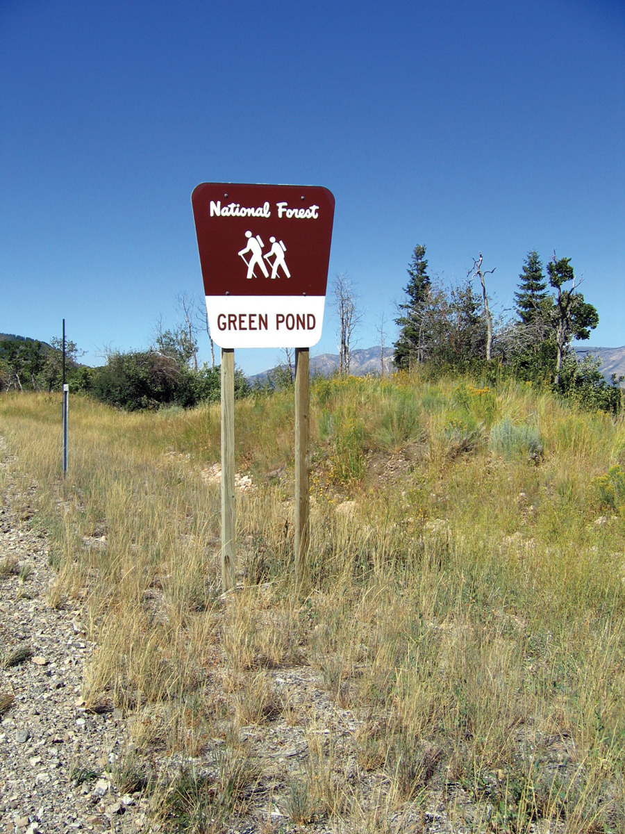 Green Pond trail sign—hike on moving ground.