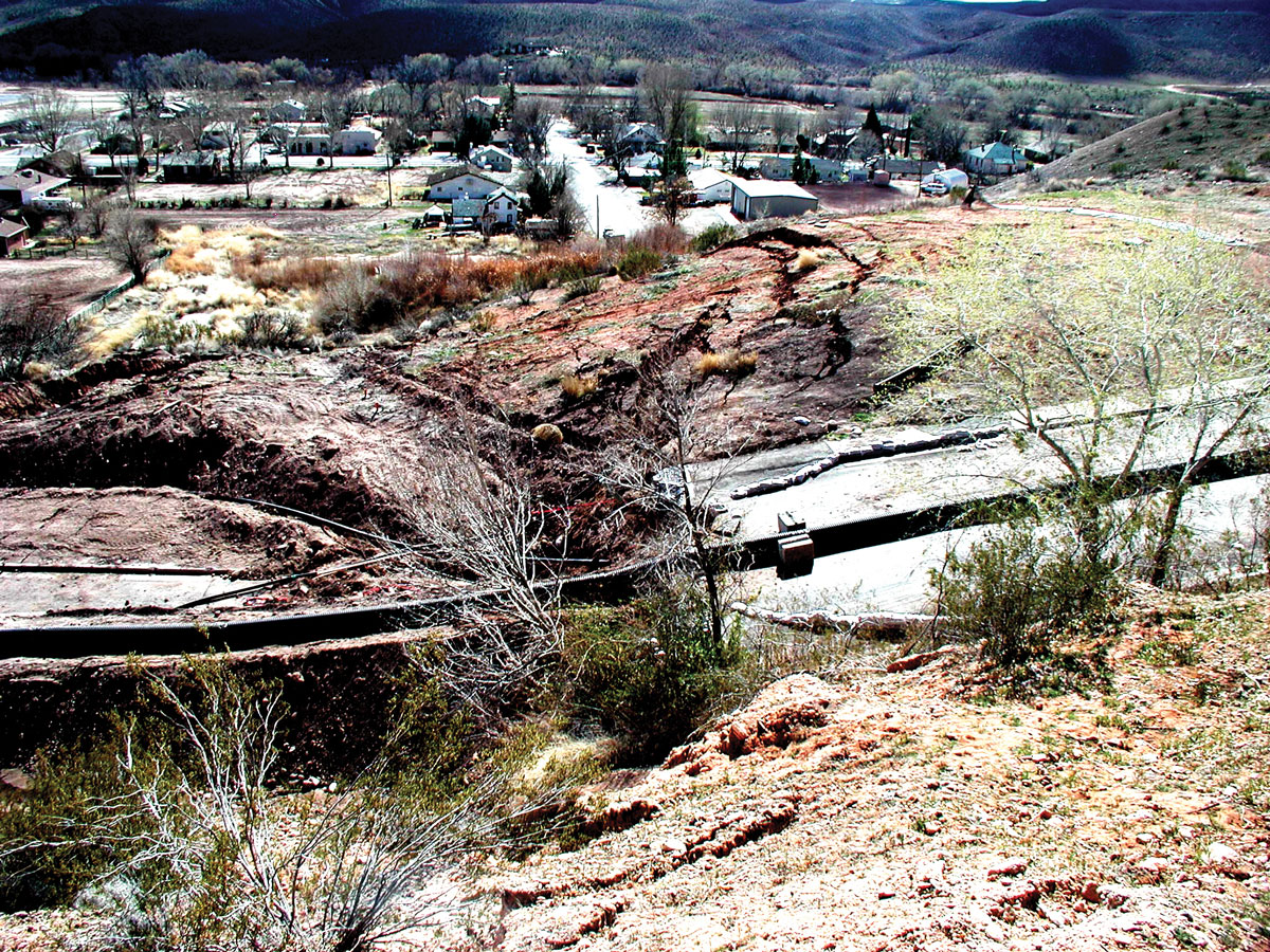A historical slope failure in the Petrified Forest Member of the Chinle Formation and overlying unconsolidated deposits has severely damaged a road and threatens nearby homes in the St. George–Hurricane area.