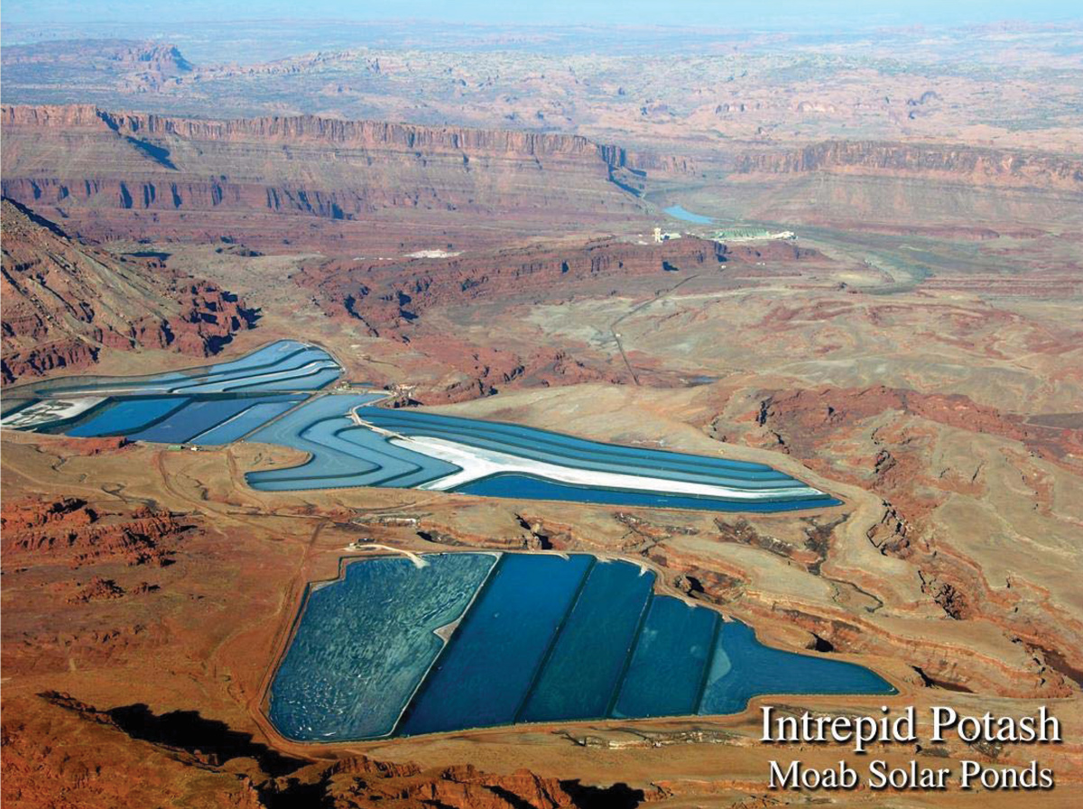Intrepid Potash's solar evaporation ponds near Moab. The blue color is caused by dye added to the brine to increase evaporation. The dry potash is harvested and hauled for processing at the plant located in the upper-right part of the image. Photo credit: Intrepid Potash, Inc.