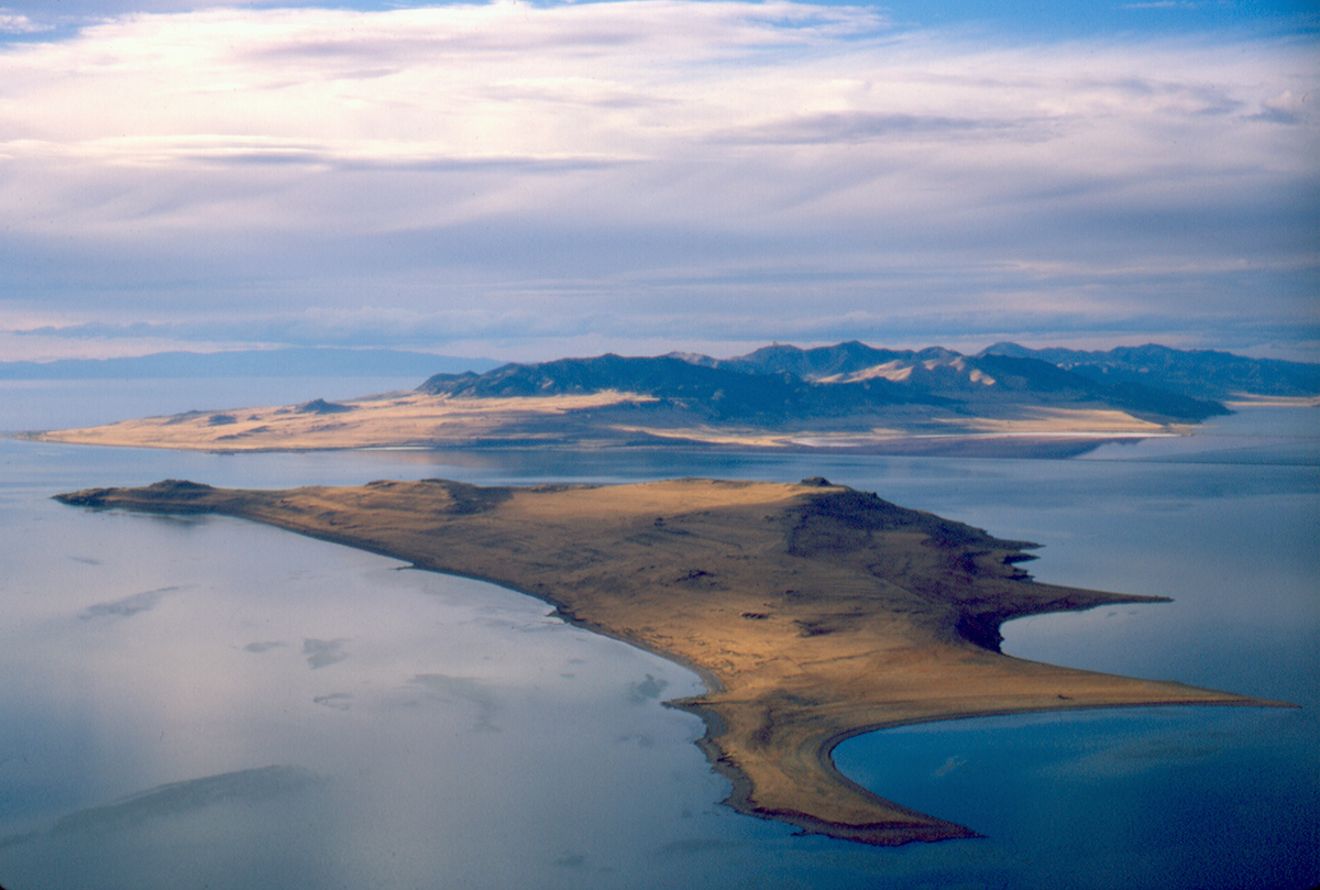 Aerial view (looking north) of Fremont Island and the nearby Promontory Mountains. Fremont Island has also been called Disappointment Island, Castle Island, and Miller's Island. (Photo source: Don Currey, University of Utah.)