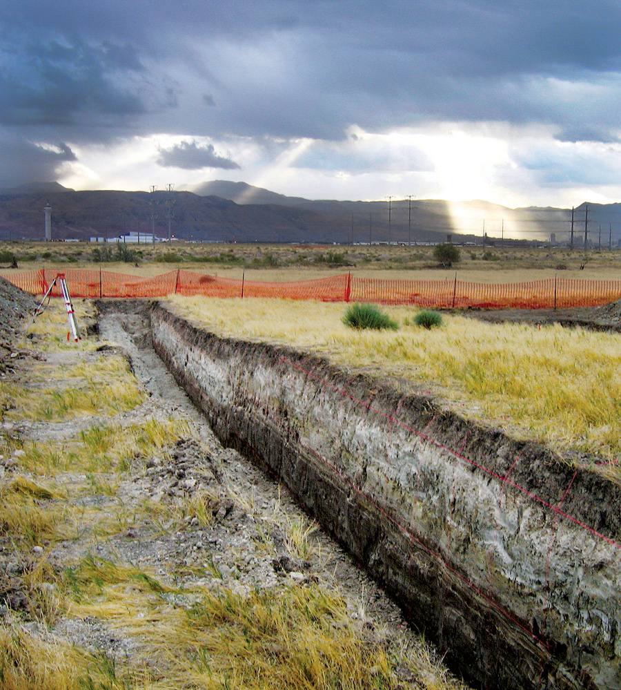 Eastward view of research trench across a small (about 3 feet high) fault scarp on the West Valley fault zone in Salt Lake Valley. Photo by Michael Hylland.