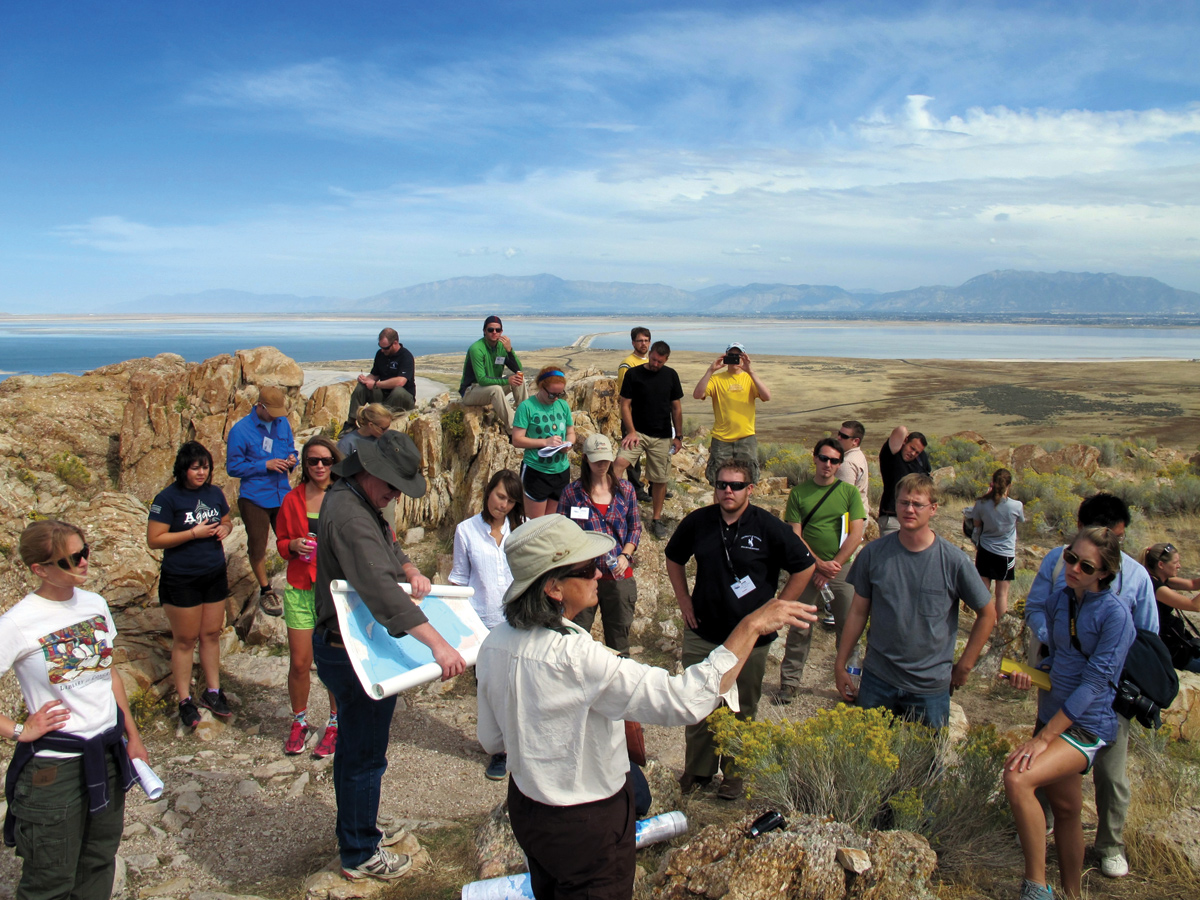 Genevieve Atwood (of Earth Science Education and former director of the UGS) points out features to geology students and young professionals on a pre-convention field trip to Antelope Island.