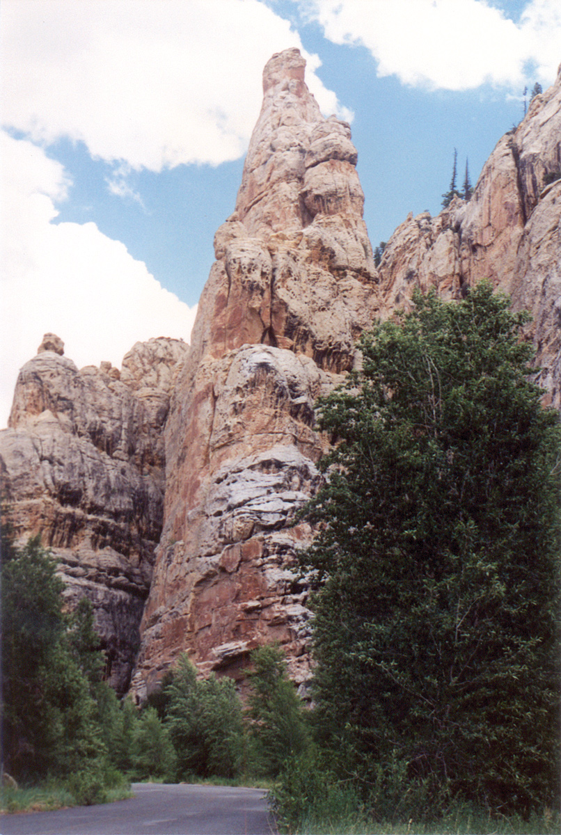 Tower Rock stands amid tall cliffs lining both sides of the canyon. These sandstone rocks were once ancient sand dunes. Photo by Douglas A. Sprinkel, Utah Geological Survey.
