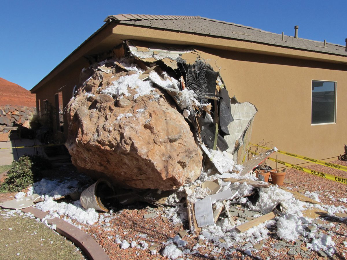 2013 St. George rockfall that damaged a residence and severely injured the occupant of the home. Photo credit William Lund, January 2013.